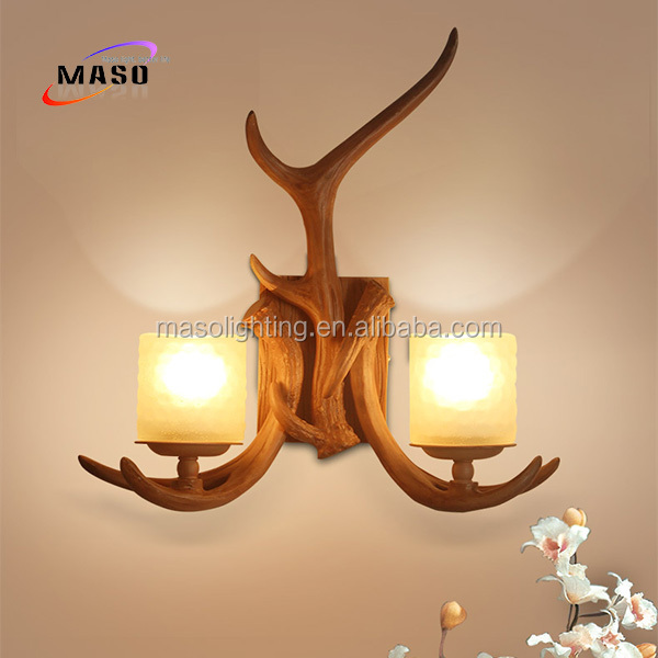 China manufacturer hotel wall light iron candle holder lamp hotel bed light vintage retro decoration antler wall lamp