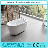 shallow small bathtub with shower