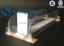 Automatic plastic shelf divider pusher system