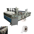 Automatic maxi roll slitting and rewinding machine