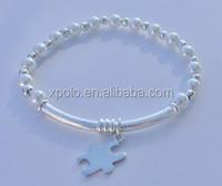 Wholesale white pearl linked Autism awareness puzzle piece charm bangle bracelet