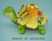 Resin garden tortoise on flower pot