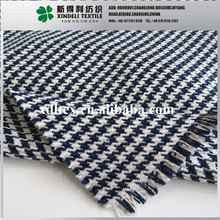 Black and white yarn dyed 33% Wool 67% polyester houndstooth fabric woven