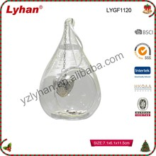 open glass ball with hanging metal angel inside for indoor decor