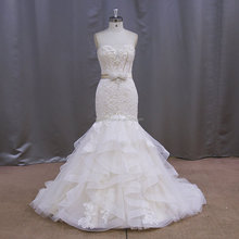 Champagne color fish tail wedding gowns with crystal beads on the belt XF1013