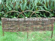 Decorative small wooden garden border edging