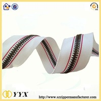 Latest design fashion metal zipper long chain, metal zip roll for bags parts