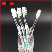 wholesale supermarket soft nylon bristle transparent rubber toothbrush