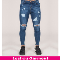 Latest design skinny stretch dark blue men jeans with heavy rips & abrasions
