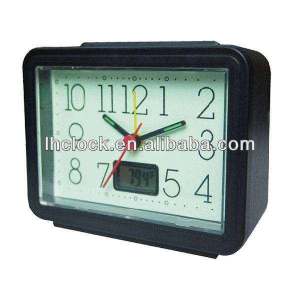 glowing dial alarm clock with temperature