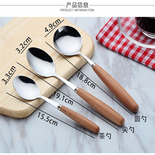 stainless steel spoon with wood handle serving spoon