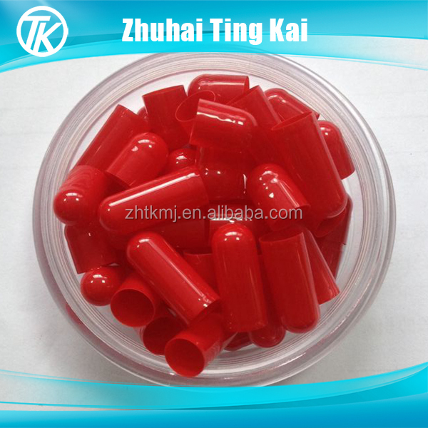 Red size 00 gelatin capsules separated