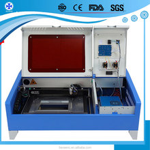 desktop mdf laser cutting machine/granite 40w 50w 3040 3050 4060 stone laser engraving machine with Reci Laser tube for agent
