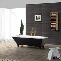 black surround solid surface free-standing bathtub with four legs