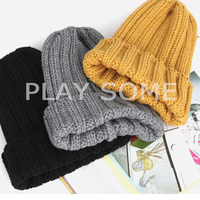 Single color young girl different types of knit hats