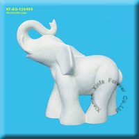 unpainted ceramic elephant figurine
