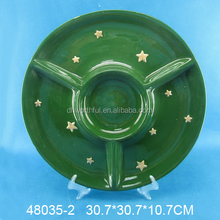 Modern green glazed ceramic section plate with golden stars painting