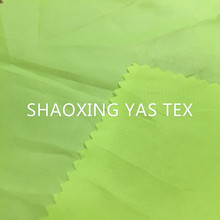 yas tex 100% polyester fluorescent green fabric light weight for bag lining textile fabric