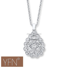 sterling silver lacy heart, teardrop and oval patterns in a pear-shaped pendant necklace