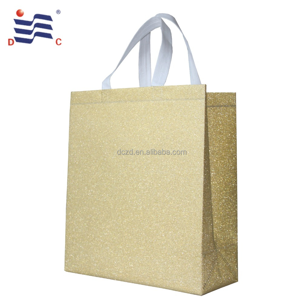 Golden heat seal glitter non woven bag in multi colors for gift packaging promotion shopping