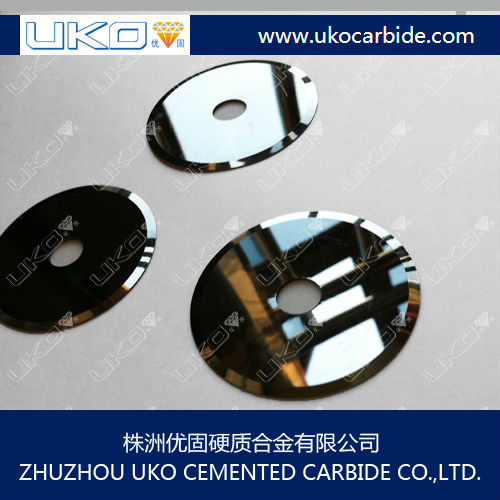 Tungsten carbide cements fiber cutting blades