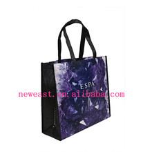 laminated non-woven tote bag with binding and cross stitch on the handle for reinforce