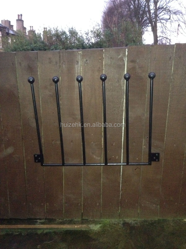 3 PAIR WROUGHT IRON WALL MOUNTED BOOT RACK