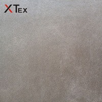 new types of 100 polyester material leather look fabrics for sofa upholstery prices