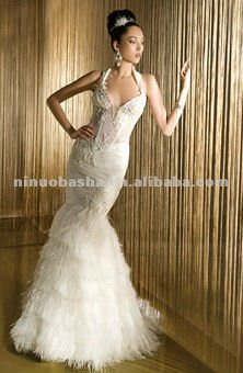 Sheer bodice with beading halter straps all fur trumpet wedding dress
