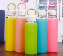 colored glass bottle/glass water bottle with silicone sleeve