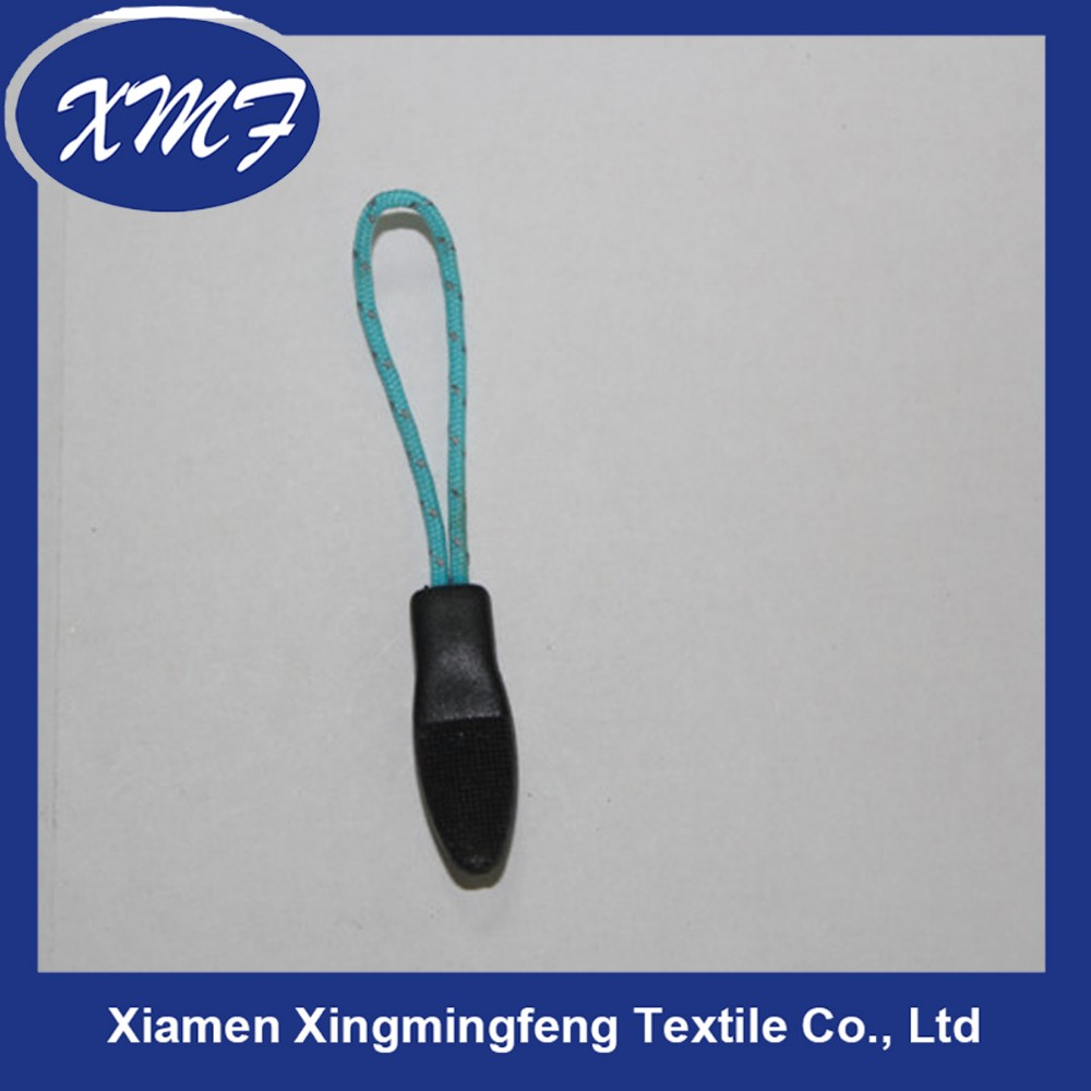 plastic zipper puller with blue string