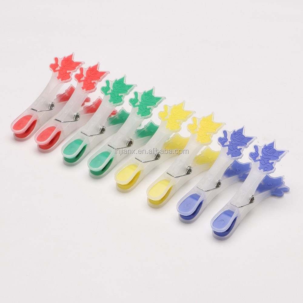 plastic clothes pegs; spring clips
