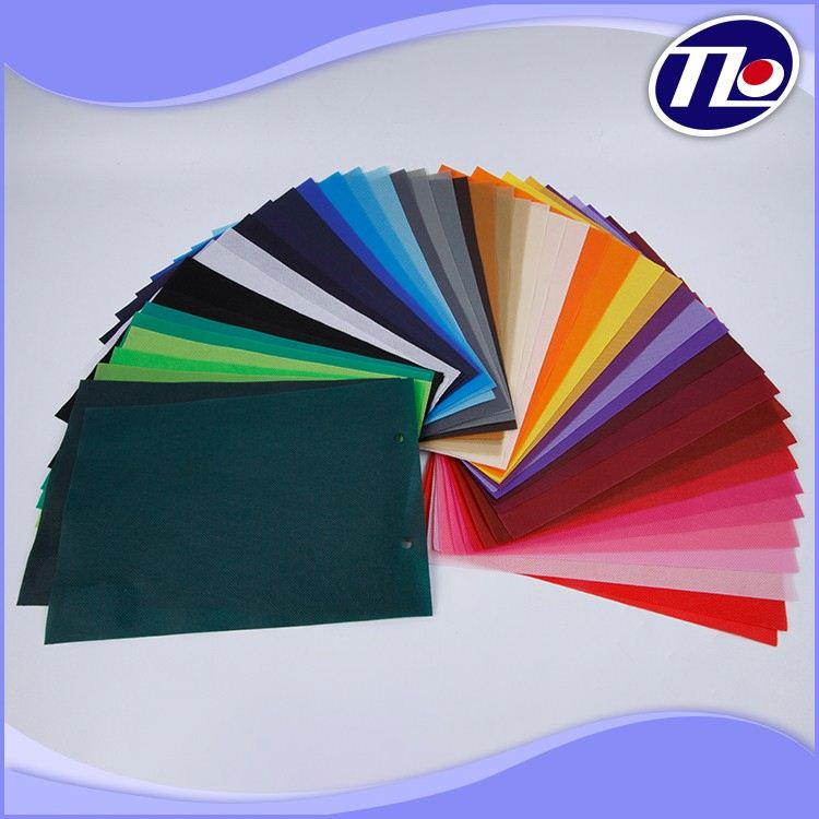 high quality 100% pp spun bonded non woven fabric / rainbow coloured non woven fabric