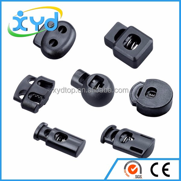 Garment accessory end cord lock spring cord stopper