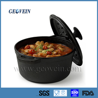 Round cast iron cocotte pot cooking chicken and potato