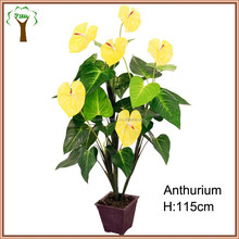 artificial green anthurium plant with yellow flowers