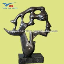 black marble stone carved abstract face sculpture