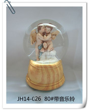 Wholesale angel and baby jesus polyresin imitation wooden base christmas clear glass ball ornaments