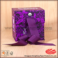Small paper flat folding gift box with ribbon for body powder