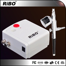 Small Portable auto air compressor with dual action air brush spray gun