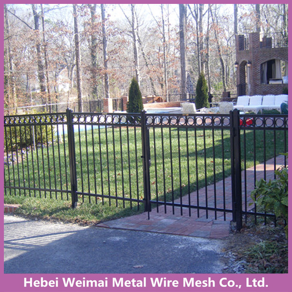 Short modern iron garden fence and gate