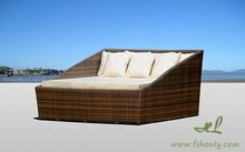 Beach sun bed or rattan lounger in outdoor furniture