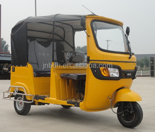 Bajaj three wheel covered motorcycle
