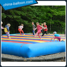 Colorful rainbow large outdoor inflatable jump pad for kids
