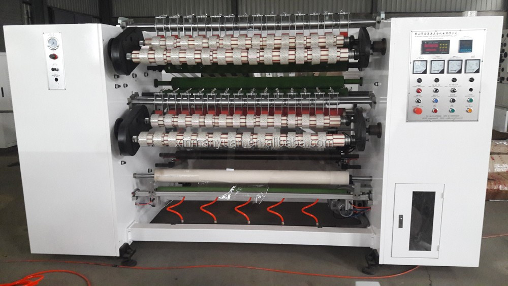 Four shaft exchange automatic tape cutting machine