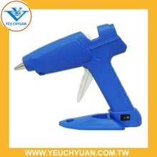 Trigger fed silicone glue gun suitable for hot melt glue stick