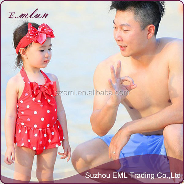cute girls with small children baby swimming beach skirt