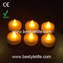 Battery operated yellow flicker flameless tea light with timer