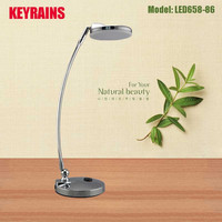 flat table lamp with lamp base outlet