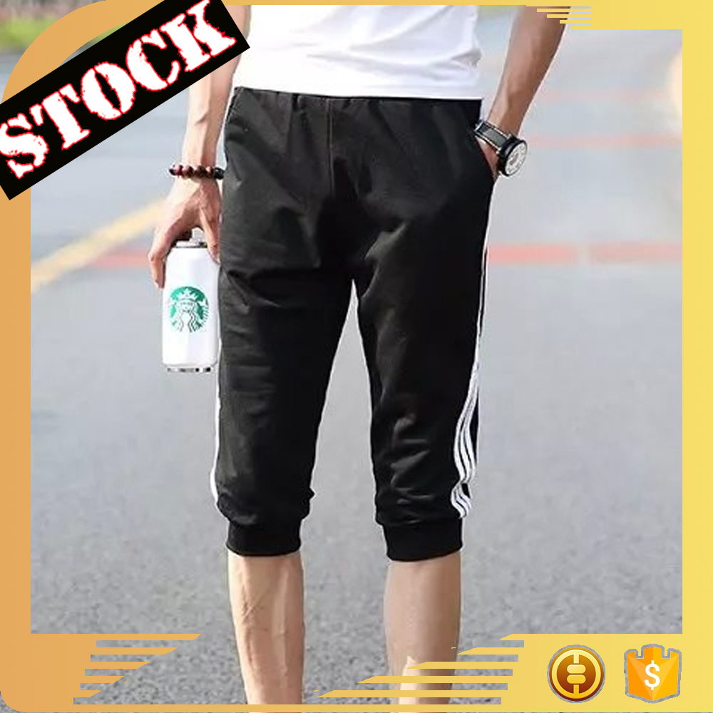 F007 Best selling in usa 2017leisure printed machine embroidery lace fabric Skin care fitness men shorts jogging wholesale china